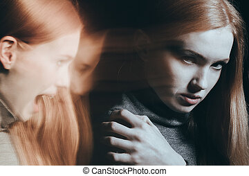 Woman with split personality, hearing voices in head