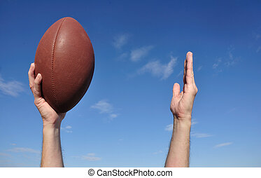 American Football Player Celebrates a Touchdown Holding a...