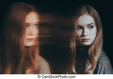 Woman with split personality - Beautiful, young woman with...
