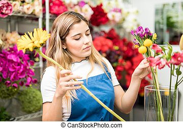 Woman working at a flower shop