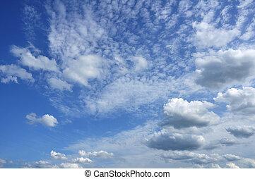 Cumulus and Altocumulus Clouds Against a Blue Sky
