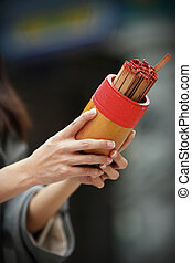 soothsaying, shake bamboo cylinder for fortune tell