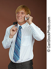 Young man talking on phone - A young man talking on the...