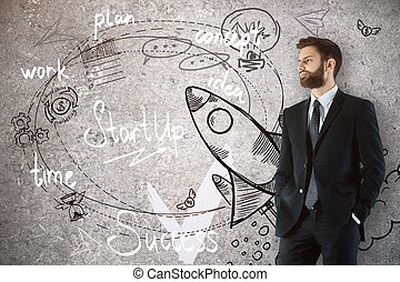 Start up concept - Attractive young man looking at rocket...