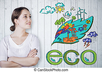 Go green concept - Cheerful young woman on wooden background...