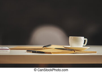 Blurry background - Close up of desktop with coffee cup,...