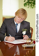 Groom solemnly signed documents - The groom solemnly signed...