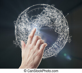 Connectivity conceot - Hand pointing at abstract polygonal...