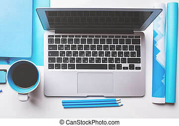 White desktop with supplies and device - Top view of white...