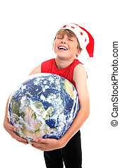 Christmas boy hugging planet earth - A happy boy hugging the...