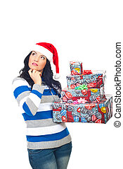 Thinking woman with Christmas gifts - Woman holding...