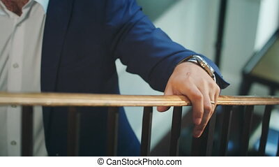 A Man Walking Up the Stairs Holding the Bannister