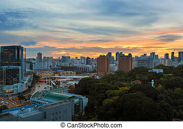 Sunset over Clarke Quay and Fort Canning Park - Sunset over...