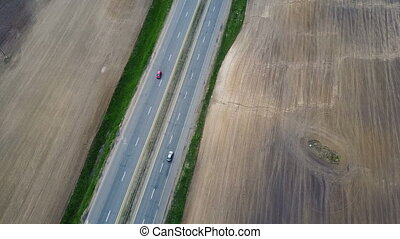 Aerial view of the traffic road. Cars driving on motorway...