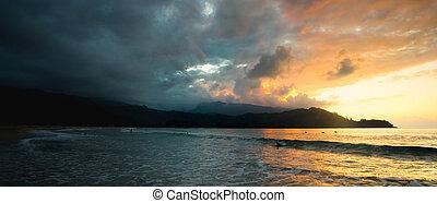Sunset in Hanalei - The sun sets over Hanalei Bay, Kauai,...