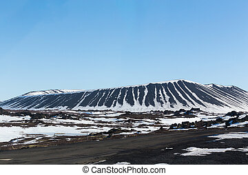 Myvatn volcano with clear blue sky background during winter...
