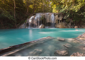 Beautiful natural blue stream waterfall in deep forest...