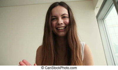 Young woman making video call