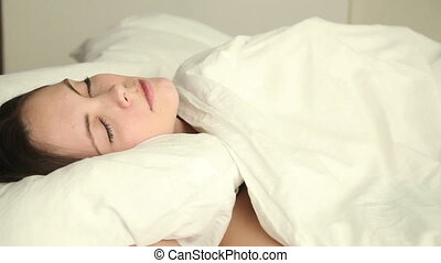 Young woman having nightmare