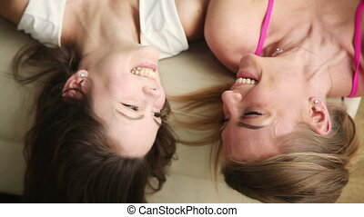 Two funny girlfriends talking and laughing - Top view of two...