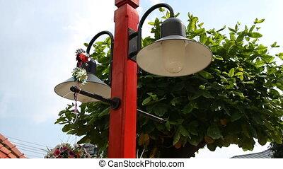 Street lantern decorations - flowers and windmill. Thailand,...