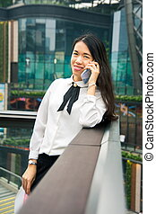 Business woman on the phone in modern environment