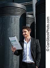 Cheerful businessman reading documents - Cheerful...