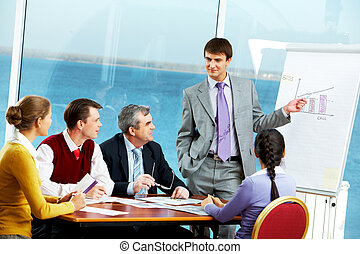 Presentation - Photo of young businessman standing near...