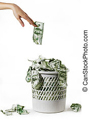 Unnecessary money - Photo of money is in a trash bucket over...