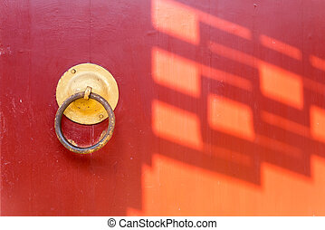traditional palace door with sunlight - sunlight cast...