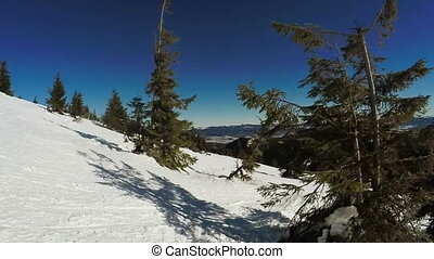 Snow-covered slope and ate - Descent on the snow-covered...