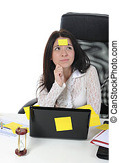 woman with laptop - Image forgetful business woman with...