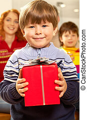 Child - Portrait of happy child holding red gift box