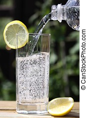 sparkling water pouring into glass