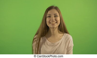 Portrait of a beautiful girl who smiles and laughs. On the...