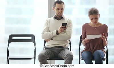 Nervous applicants waiting for job interview - Two young...