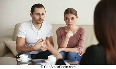 Young couple visiting psychoanalyst - Family facing...