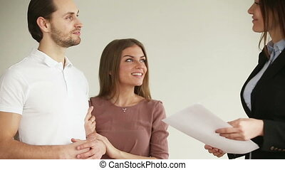 real estate agent - Young attractive happy smiling couple...
