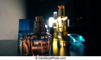 Woman's finger pushing perfume sprayer in the dark. Slow...