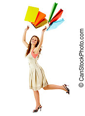 Happy shopper - A cheerful girl with paper bags isolated on...