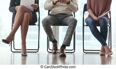 Group of people waiting for job interview - Group of three...
