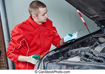automobile car oil replacement work - Motor oil replacement....