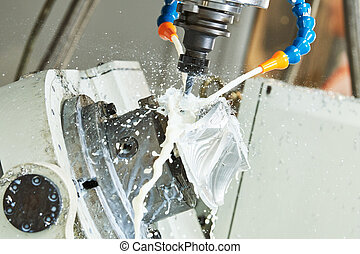 Milling metalwork. CNC metal machining by vertical mill with coolant