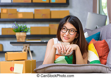 Young casual asian beautiful girl entrepreneur relax on the...