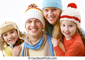 My family - A portrait of a happy family of four in winter...