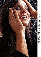 Wet girl - Portrait of a young drenched brunette in black