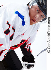 Close-up of player - Vertical image of ice-hockey player...