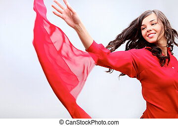Throwing a fabric - A girl in red throwing red fabric