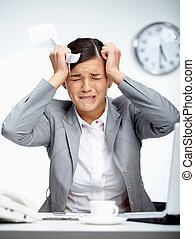 Failure - Image of young employer touching her head in...