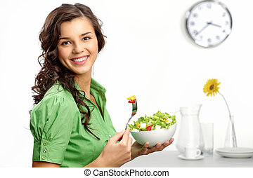 Keeping a diet - Portrait of a girl looking positive and...